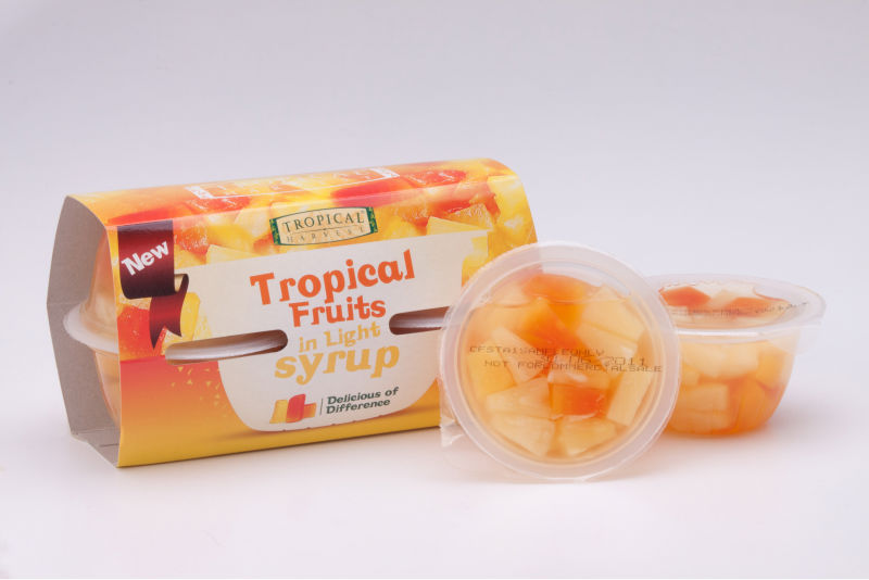 Tropical fruit salad in plastic cup