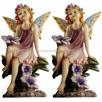 Hot sale garden cherub decoration holding flowers resin fairy statue with wings
