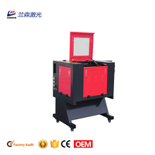 Auto Focus motorized up and down table red dot pointer 300*500mm co2 60w Paper wood a3 laser cutting