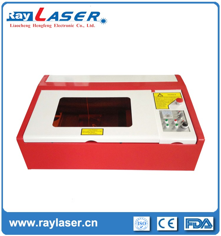 manufacture ST40GU mini desktop paper wood leather acrylic co2 laser engraving cutting machine with good after-sales servcie
