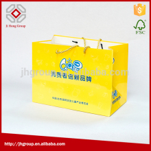 Can be customized fashionable low cost minimum order shopping kraft paper bags wholesale with cotton-handle paper