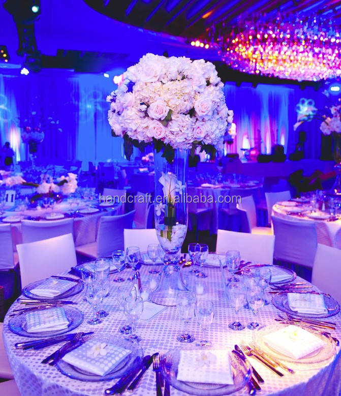 Tall White Centerpiece in a silver lined vase
