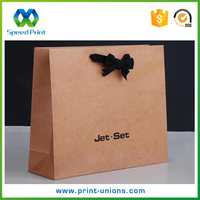Decorative gift paper bags with bow tie ribbon
