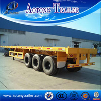 Hot selling leaf spring suspension 12 wheels tri-axle 40ft flatbed trailer with container lock