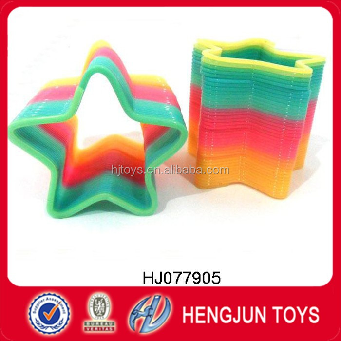 wholesale plastic star shape spring rainbow toys for promotion