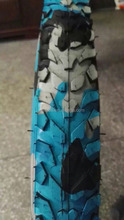 blue camouflage bicycle tyre