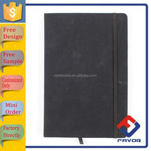 yiwu stationery market producing embossed logo exercise notebook with blank pages