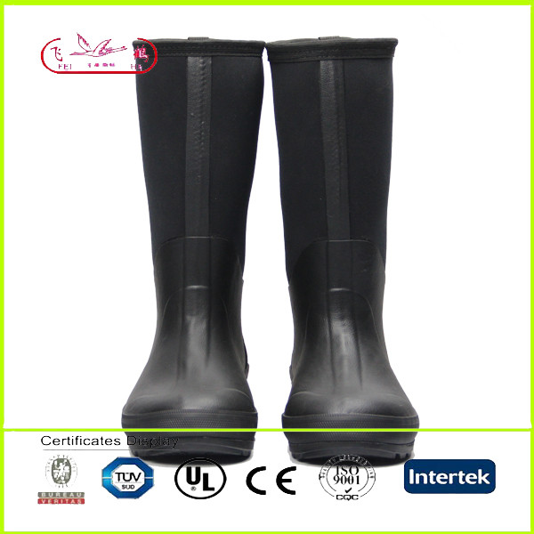 Knee high rubber work boots