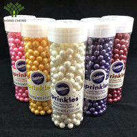 Wilton Sprinkles of different colors and shapes for cake decoration