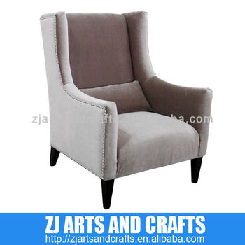 0471 arm sofa ( Taupe Velvet arm chair with silver studs around arms and base with wenge finished legs)