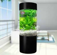 cylindrical acrylic fish tank with black stand
