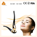 Small handy golden beauty applicator anti-wrinkle eye massager