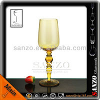 tall stem yellow colored beaded red wine glass