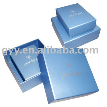 Square blue box with silver logo