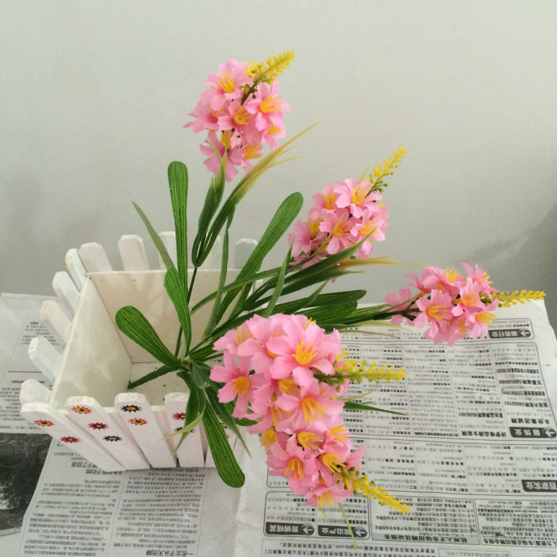 artificial flowers in acrylic water