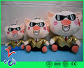 Plush piggy toy wearing suit and black glasses