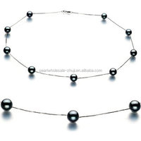 tin cup black pearl necklace, 18k gold fittings