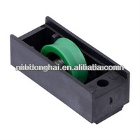 Door and window rollers with nylon surface and embedded nylon wheel