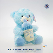 cute teddy bear with feeding bottle