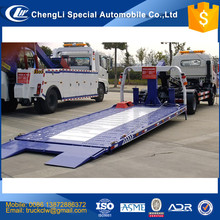 CN Cheap price of 0 degree flatbed wrecker towing truck dimensions 5600x2300mm 4 ton 4x2 rescue hydraulic control tow Customized