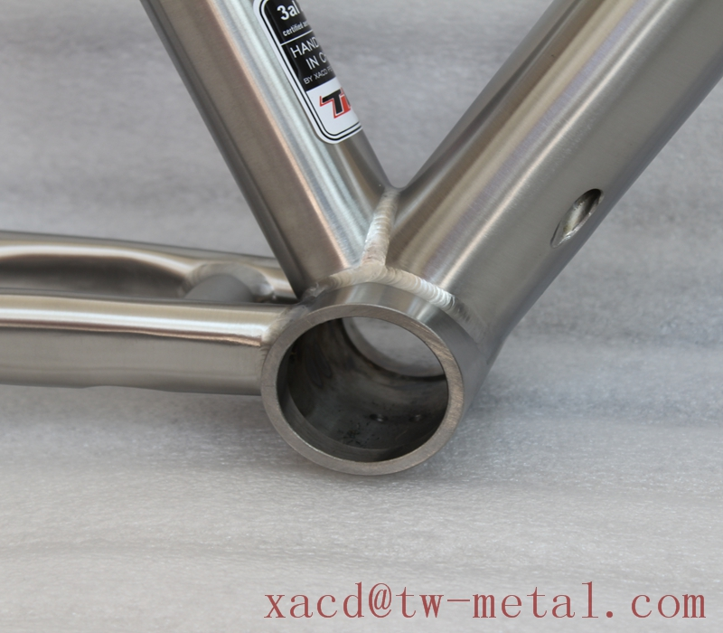 Custom titanium road bicycle frame with inner line routing and taper head tube and breeze dropouts Titanium road bike frame