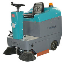 Double brush electronic ride on shop sweeper