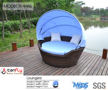 Wicker rattan lounge round chairs with canopy.