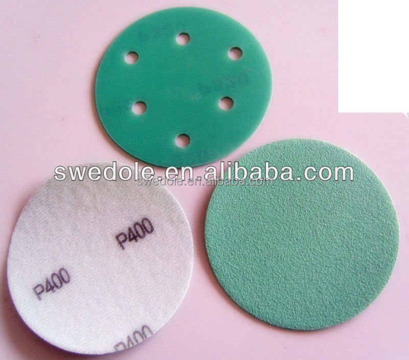 Green round sanding disc for polishing metal and wood