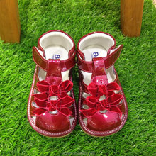 Beautiful baby girl of kids shoes match baby dresses