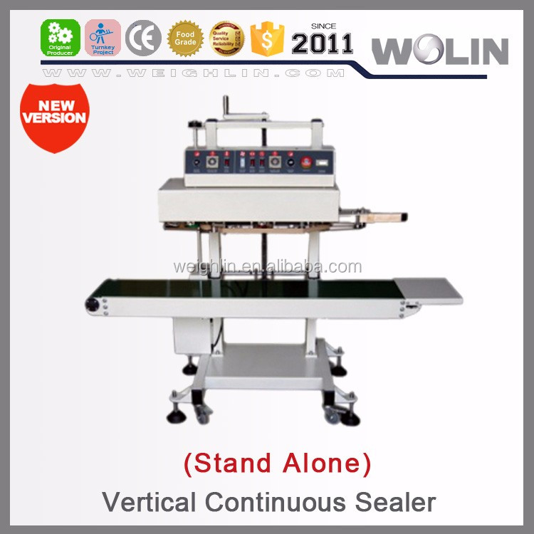 Welin tabletop flow flat stand alone vertical continuous band sealer sealing machine for premade performed standup pouches