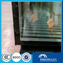 Reflective insulated tempered glass panels for windows
