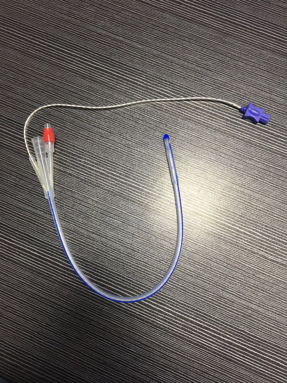 Factory supply disposable foley catheter with temperature probe, 400 or 700 series