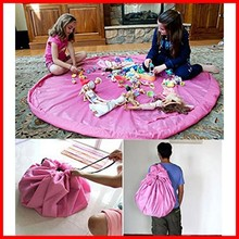 "The large 60"" diameter floor activity mat turns into a shoulder bag in just seconds! Playmat is perfect for storing small toy"