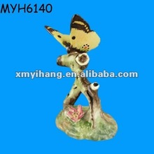 Artificial tree branch and butterfly statue