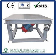 vibratory platform for construction material