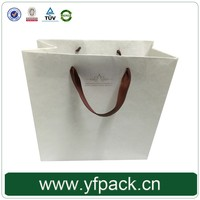 China Wholesale Decorative Luxury Recyclable Fashion Gift Paper Bags with Your Own Logo