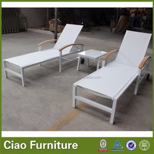 Outdoor sling sun lounger with wheels and teak wood arm