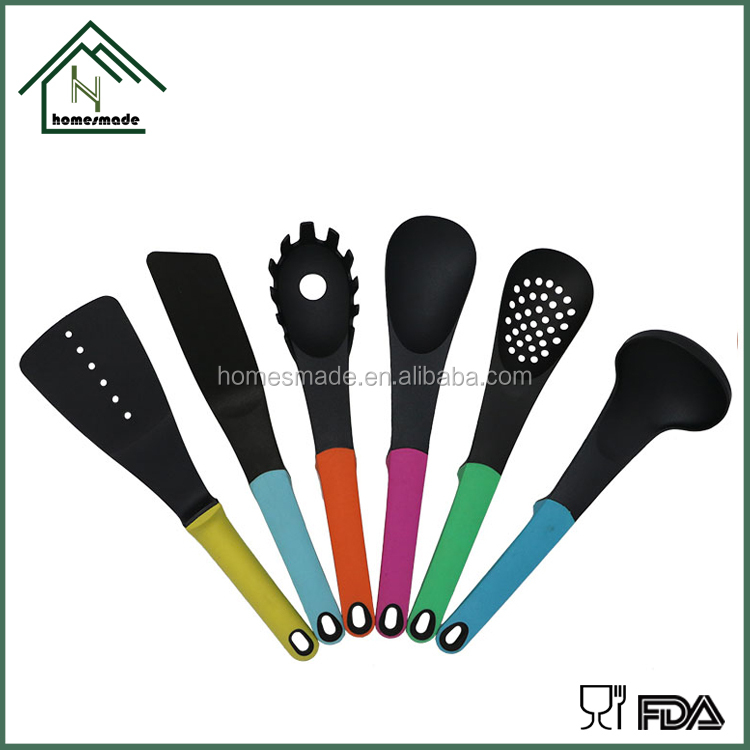 Moden multi colored cooking utensils set with plastic rack