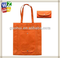 Promotional foldable nonwoven shopping bags,Orange non woven fabric foldable tote bag,non woven shopping bag