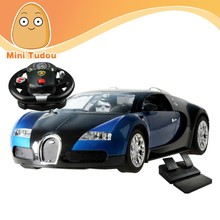 1:14 4 CH RC Car with LED lights and steering wheel Foot pedals gravity sensing remote control car