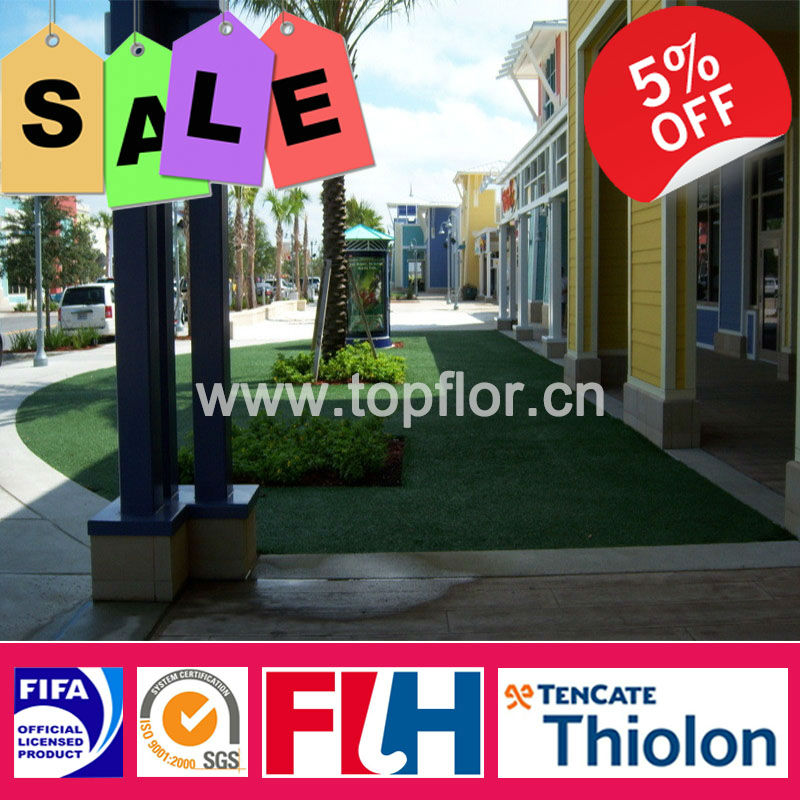 Child and pet friendly artificial grass with drainage holes on backing