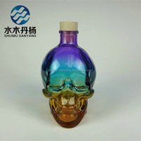 Colored skull shaped wine glass bottle with cork