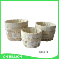 Delicate round willow laundry basket with fabric liner