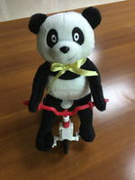 singing panda in tricycle