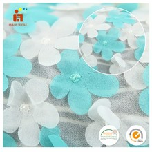China wholesale blue white 3D flower applique laser cut embroidered tulle fabric
