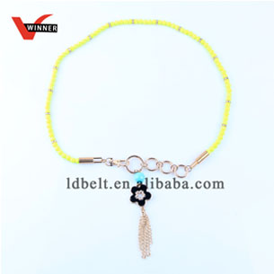 Neon yellow beading metal tassel skinny waist chain belt