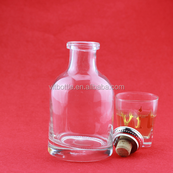Low price good quality empty milk bottles crystal head whiskey bottles vodka glass bottles