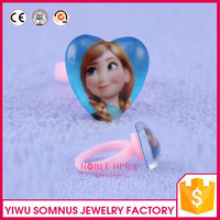 plastic finger ring with crystal heart and frozen figures inside