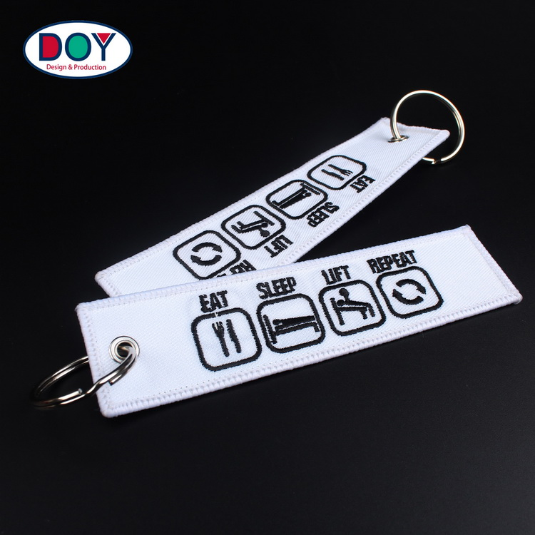 China Manufacturer 3D Custom Logo Branded Name Embroidery Tag Promotional Key Chains