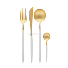 Wholesale royal 304 stainless steel gold cutlery set with white black handle